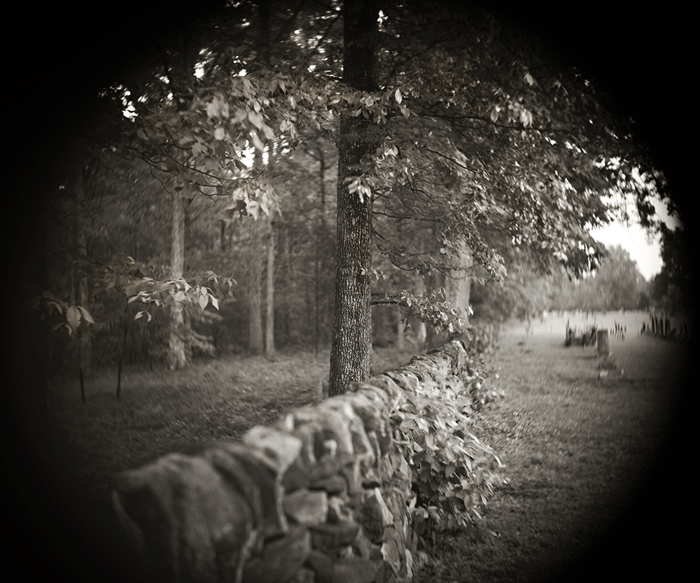 "Divided in Death: This image reflects how those enslaved were buried outside of the cemetary wall. The enslaved were buried on the left and the church parishners were buried on the right. This photograph taken with an 8"" x 10"" camera using a Darlot brass barrel lens. The church was founded in 1767. My family was visiting this church when we discovered the history here. The church is dedicated to preserving and caring for the enslaved graveyard."