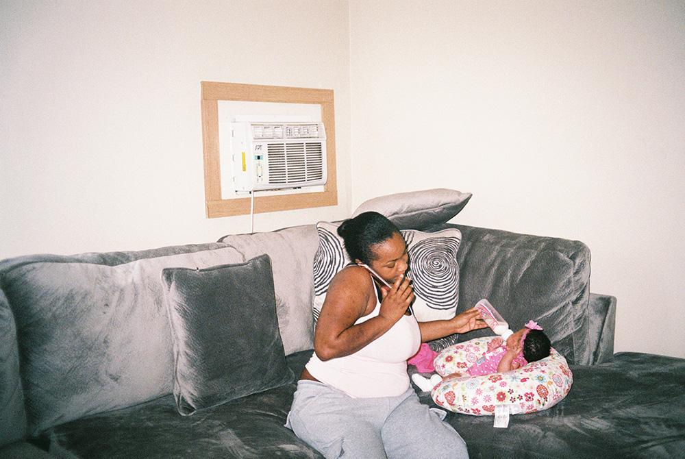 Donna feeds her one-month old daughter, Lyric, at the home she shares with her boyfriend and other two children.