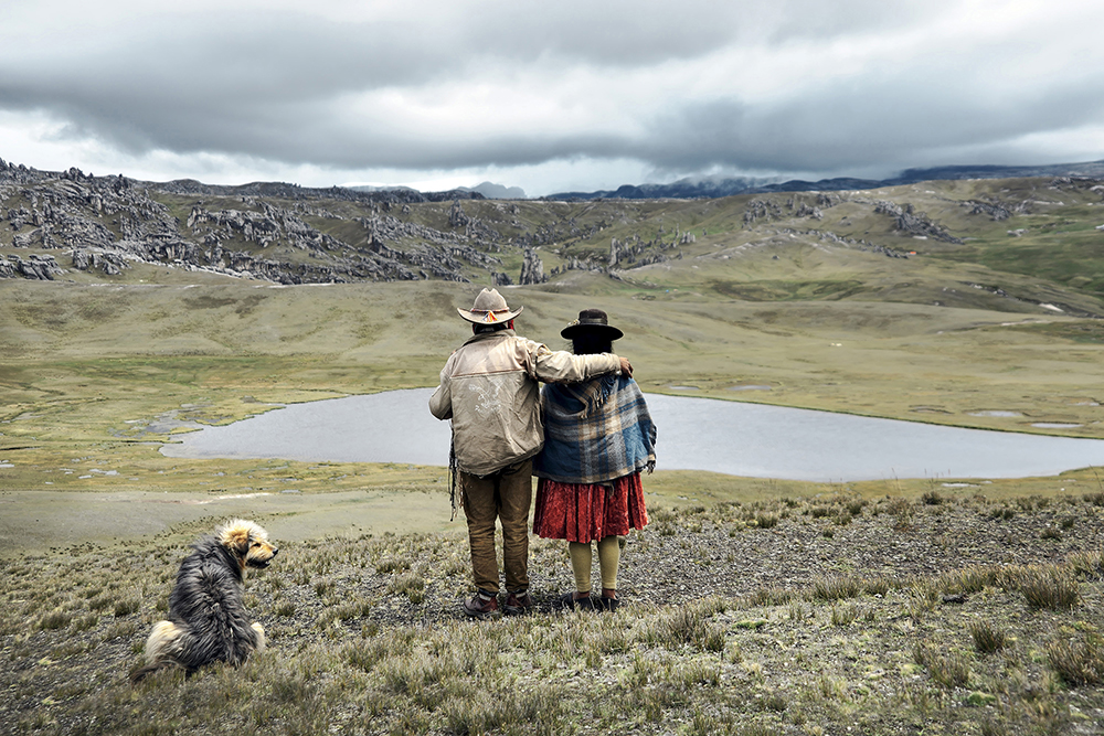 Somewhere at the highlands, an unusual scene: a couple working together, as partners.