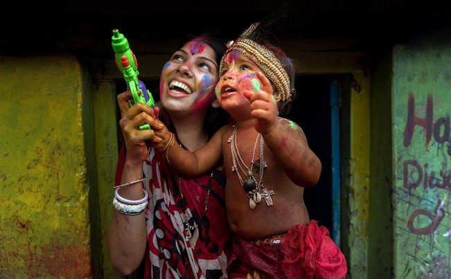Kazi Md. Jahirul Islam_Happy mother with little Son on holi color festival.