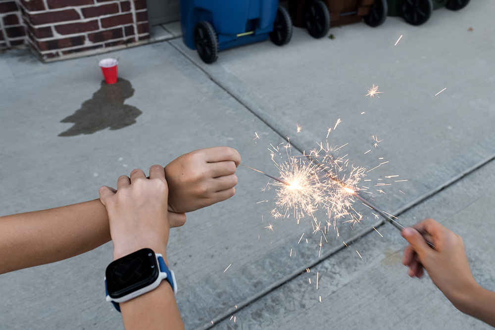 11 Karen Osdieck Joey lighting Jackson's sparkler
