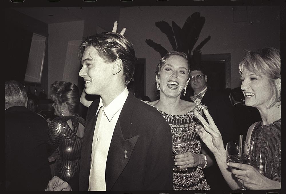 Leonardo DiCaprio, Sharon Stone & Ellen Barkin  at  Producer Steve Tisch &  Vanity Fair's Oscar Night Party, Mortons,  Los Angeles. March 1994.  Film 94559/25