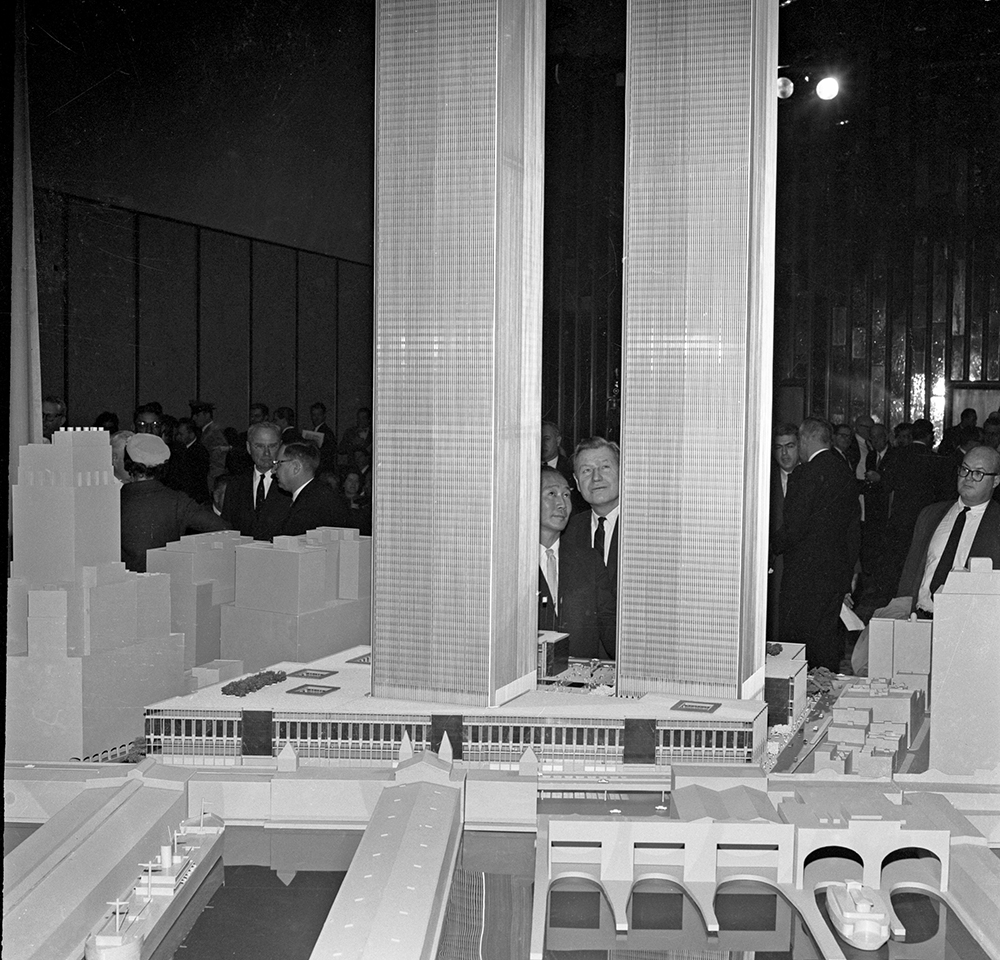 Governor Nelson Rockefeller looks at a model of the World Trade Center, with its architect Minoru Yamasaki, at the New York Hilton Hotel in Manhattan, January 19, 1964. (Photo by John Campbell/NY Daily News via Getty Images)