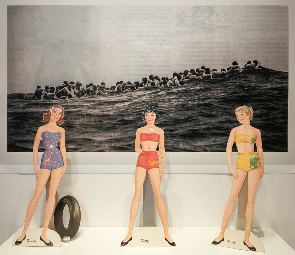 2019; 1940s paper dolls, contemporary newspaper photograph by Santi Palacios, contemporary shelf; 37 x 44 x 10 in.