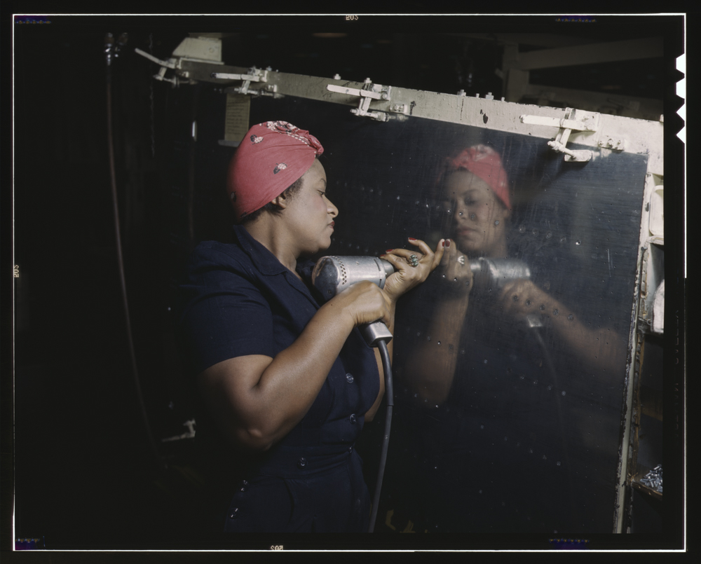 Operating a hand drill at Vultee-Nashville, woman is working on