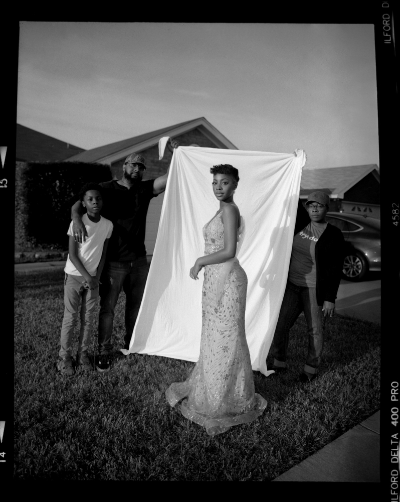 "Jordan Buie, 18, foreground, wears the dress she planned on going to prom with before it was cancelled due to COVID-19 concerns on Monday, May 11, 2020 in Killeen, Tx. ""I cant keep stressing myself about something I cant control,"" Orion said. Also pictured (left to right) is her brother Caleb Buie, 13, father Burnice Buie, 39, and mother Wilzata Buie, 38."