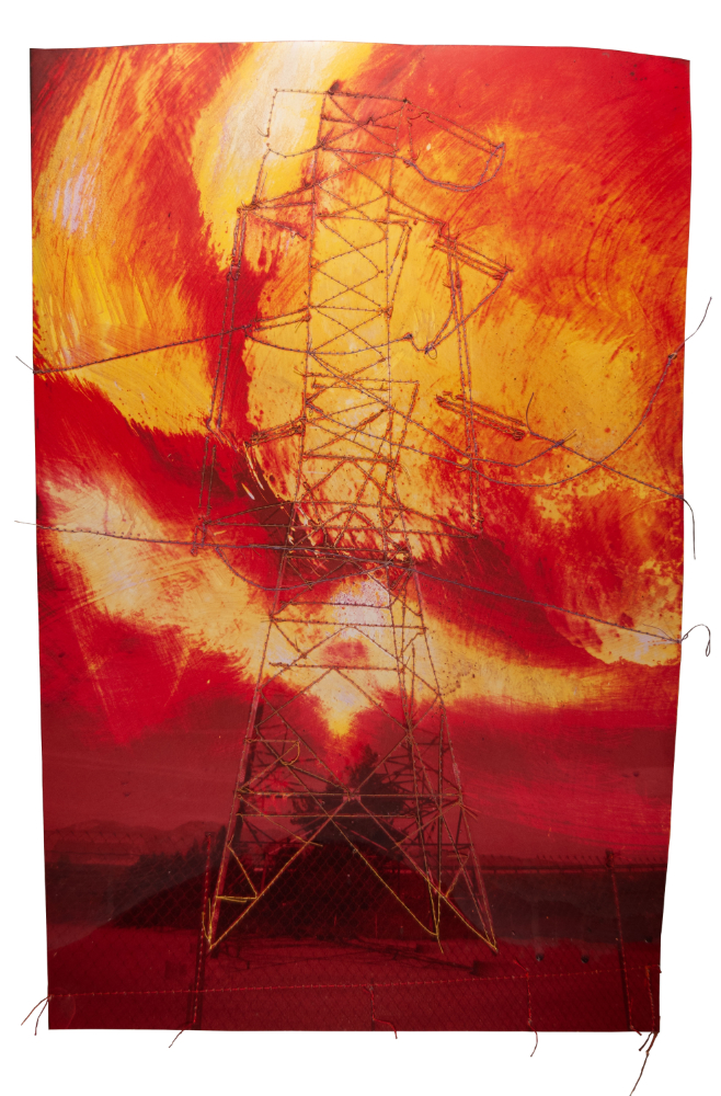 Transmission tower with fire sky