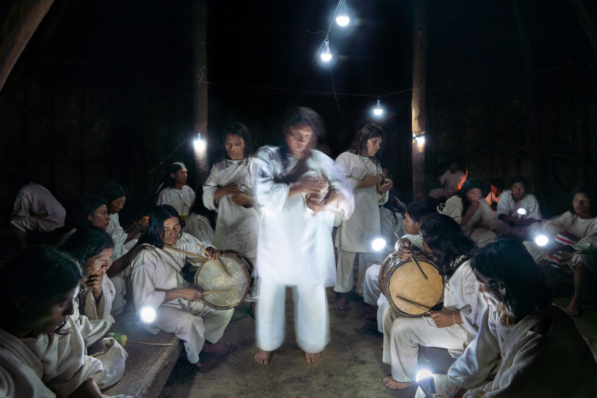 Kogui men play music during a Cualama ceremony at night in 'la Casa Maria' a meeting space for men only in Waniyacka community. Cualama is a 10 day ritual which happens twice a year, in April and June paying honor to the change in season, mother nature and asking for abundant rains for a good harvest. This community made up of 55 homes within Colombia's La Guajira, all have solar panels as they are too remote to be connected to the grid. The Kogi meaning ÔJaguarÕ are an indigenous ethnic group living in ColombiaÕs Sierra Nevada, deeply rooted in their belief that people and nature are one. They understand the Earth to be a living being and see humanity as its ÔÕchildrenÕÕ. They are unique among Latin AmericaÕs indigenous cultures because the Spaniards never conquered them. They represent the most complete surviving civilization of pre-Colombian America.