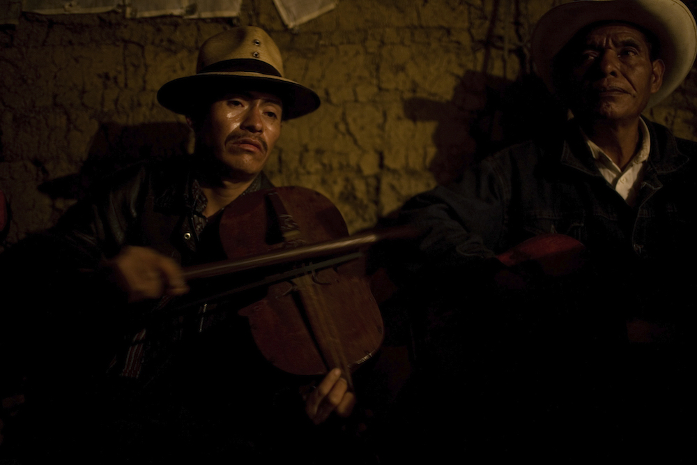 Musicians perform during the burial of six members of a family killed during a massacre made by the Guatemalan Army in 1981, in Cocop,Nebaj, around 300 km northwest from Guatemala City, Monday, June 9, 2008. After the exhumation of 76 villagers killed April 16, 1981, in Cocop, Nebaj, a forensic antropologists team made a cientific study of the bones and clothes of the massacred villagers in order to identified them. After more than 2 years of study, the antroprologists are giving the remains to their relatives, do they can make a burial in the comunity. During the 36 years of civil war in the country, around 250.000 people were killed or dissapeared.(AP Photo/Rodrigo Abd)