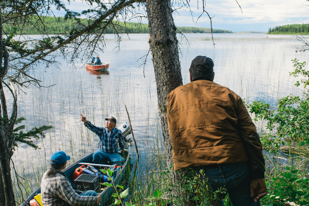 A group elders pull up to shore on Ekali Lake, near the small community of Jean Marie River, NWT. The area is rich in history - archeologists have uncovered many signs that this particular spot was an important meeting place (stone knives, buried fire pits and tools have been found here.)