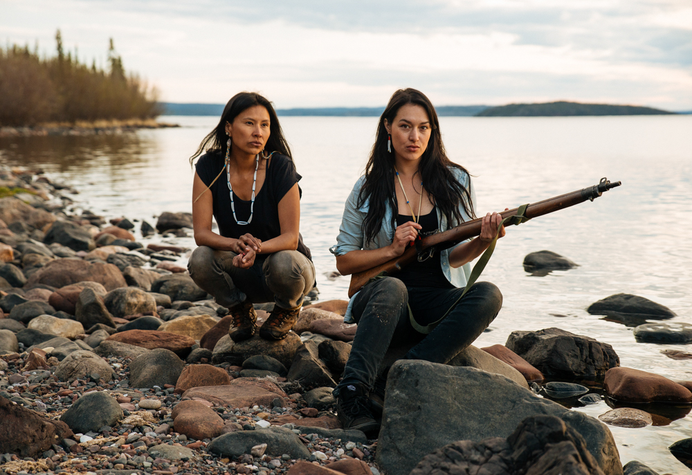 "Melaw Nakeh'ko and Angela Code on the shoreline near a camp outside of Lutsel'ke, Northwest Territories. The women are part of a moose hide tanning camp where community members gather to learn the process of tanning hides for clothing.  Nakeh'ko is a member of Dene Nahjo, an organization of young leaders looking to advance social and environmental rights for indigenous people in the NWT. Their motto is ""Land, Language and Culture Forever."""