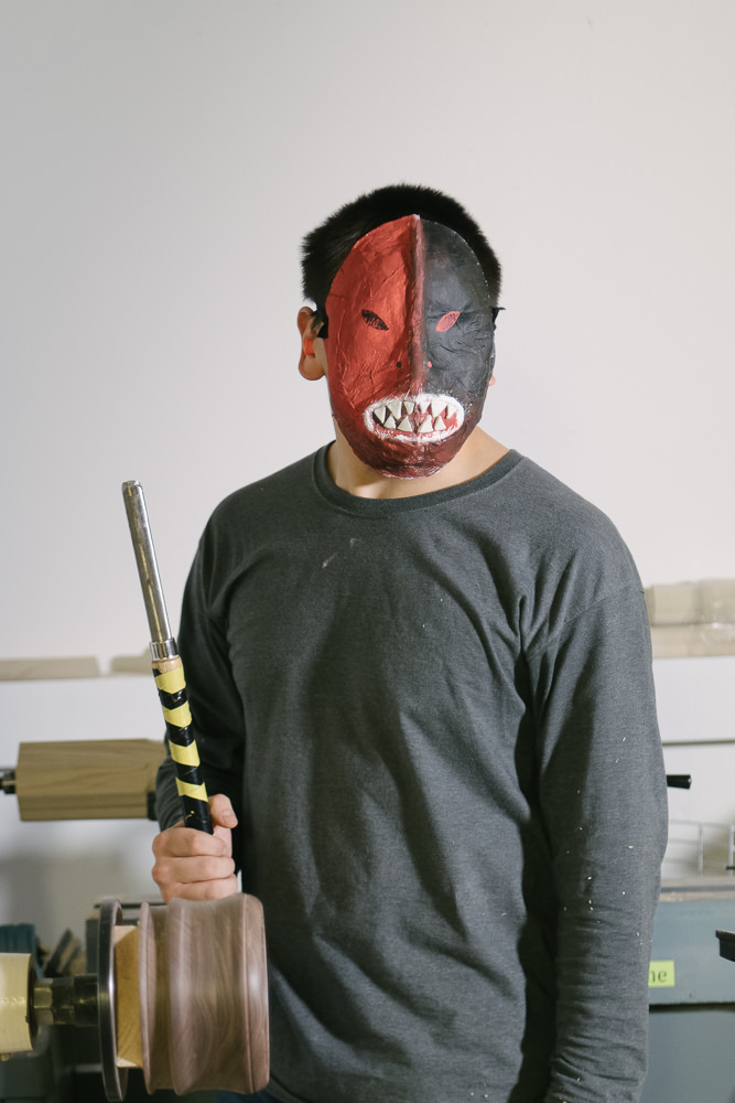 BK wears a fierce mask that is his interpretation of hope and strength. Holding a chisel in his school's shop class, he hopes that occupational training will help him to land a good job when he graduates.
