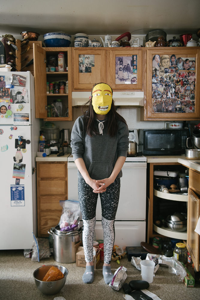 IK feels a sense of relief when she is at home with her family. She wears her hope mask in the family kitchen, where so many of her joyful memories come from.