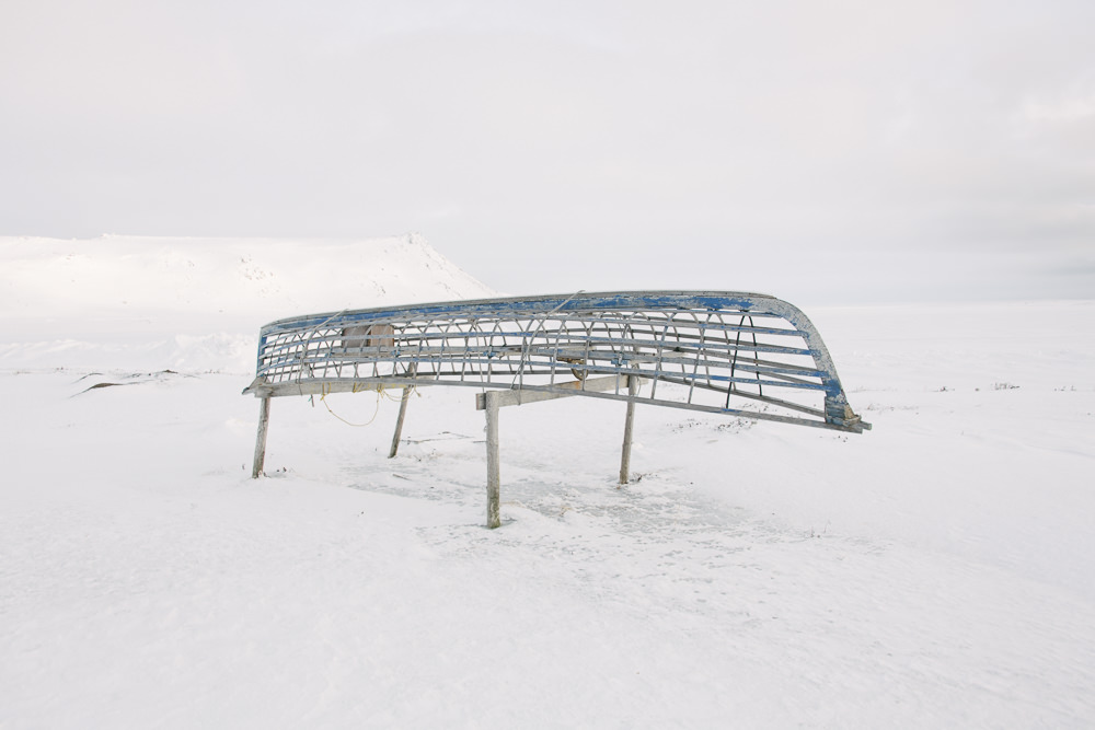 """The frame of a skinboat rests on trestles, a reminder of Yup'ik traditional culture. For the youngest generation of Yup'ik, traditional culture can be a lifeline. 16-year old Sam Schimmel from Gambell says, """"What I've seen is that when youth are not culturally engaged, you see higher rates of incarceration, higher rates of suicide, higher rates of alcoholism, higher rates of drug abuse — all these evils that come in and take the place of culture."""""""