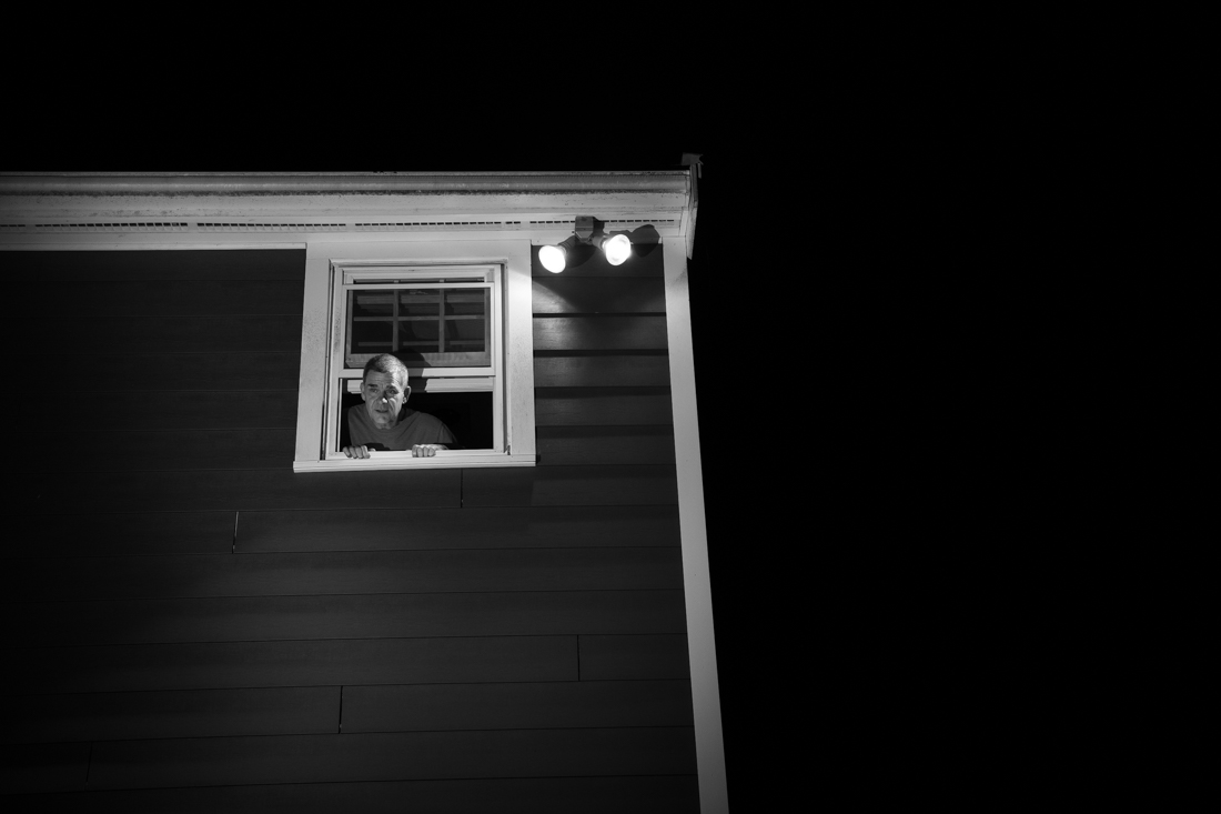 Rob Hickey looks out the bathroom window, Arlington, MA. May 17, 2020