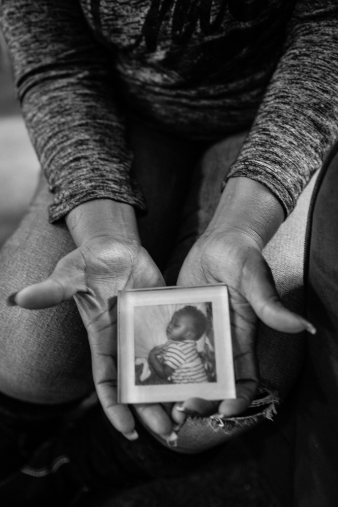 Keshena Williams, of Tacoma, Washington, holds the photo of her son, which kept her motivated to better hersel while in prison. That same son, now 18, was recently convicted and sent to prison.