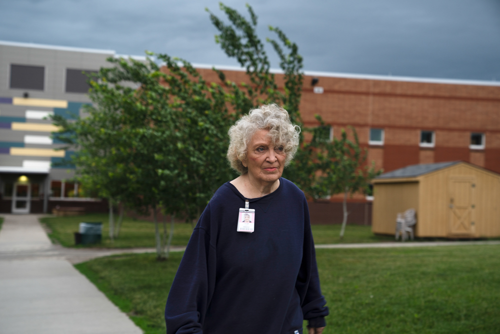 Kathy Tyler, an 82-year-old woman incarcerated at Iowa Correctional Institution for Women (ICIW) in Mitchellville, Iowa, walks to the cafeteria for lunch. Kathy recieved a life sentence in 1978 when she was 42 years old; she's been at ICIW for almost half her life.