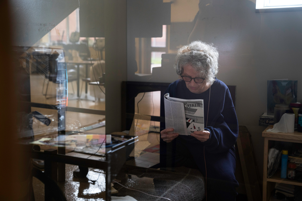 Kathy Tyler, an 82-year-old woman incarcerated at Iowa Correctional Institution for Women in Mitchellville, Iowa, stays connected to what's happening in the world by reading The New Yorker.