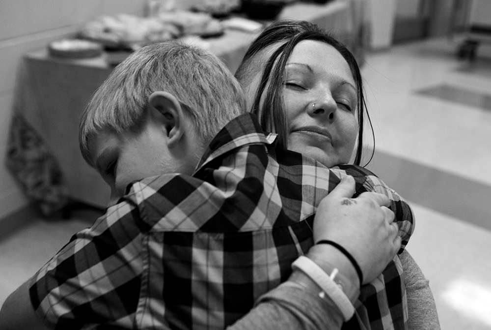 Tera Crowder hugs her son James, 7, during a special face-to-face visit Thanksgiving day at the Chesterfield County Jail.