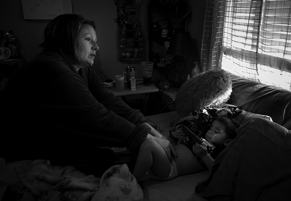 """On New Year's Eve 2019, Tera Crowder changes her youngest son's diaper. Jaydian, 2, was born while Tera was incarcerated. """"I had him with my ankle cuffed to the bed while a Riverside correctional officer watched. I got to hold him for two days,"""" she said. Tera touched her son again for only the second time when they reunited in 2019."""