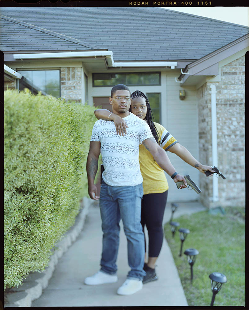 """Jamyce Brown, 29, right, embraces her husband Keon Brown, 27, outside of their home on Sunday, April 18, 2021 in Killeen, Tx. """"In my hometown introducing a child to a gun may be potentially setting them up for failure,"""" Chicago native Jamyce said."""