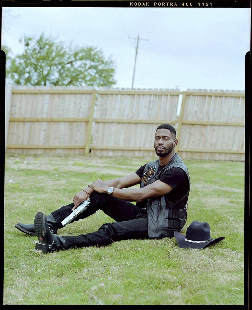 """Devin Meadows, 29, holds his firearm outside of his home on Tuesday, April 06, 2021 in Copperas Cove, Tx.  """"We as Africans Americans have been deprived of so many rights so why not take advantage of the ones we have,"""" Meadows said."""