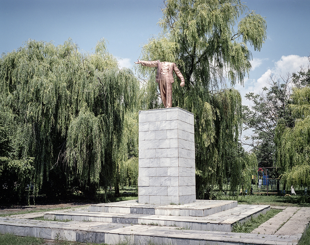July 2015, Dniprovka Village Headless statue of V.Lenin , painted gold stands in the center of the village by Energodar City, where biggest in Europe Atomic Power Station is located , on the bank of Kakhovka Reservoir on Dnieper River.