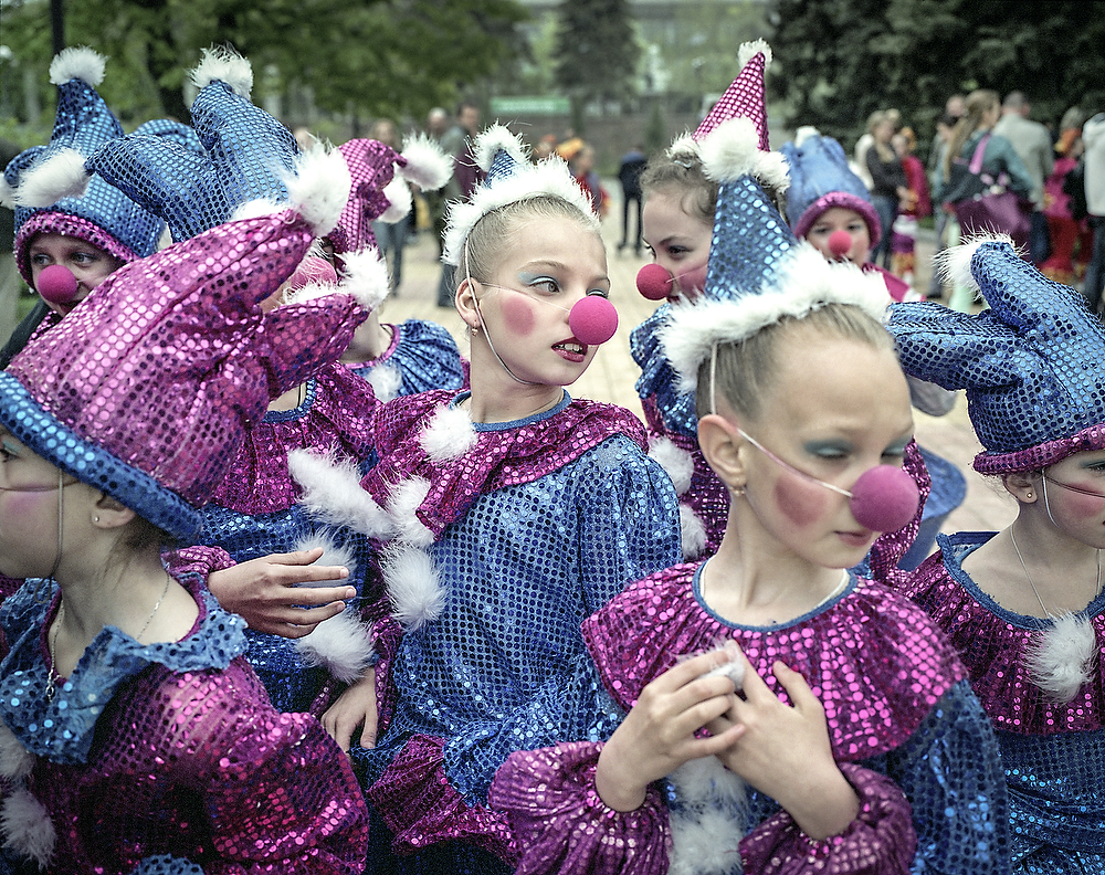 May 1 Celebrations in Donetsk, 2015 , Ukraine  School children from Donetsk dressed as clowns getting ready to perform for the public . On May 1 amid the shaky cease fire city of Donetsk celebrated Workers Day , in the city park performers presented for the first time exclusively Russian Folk Dances while non  Ukrainian.