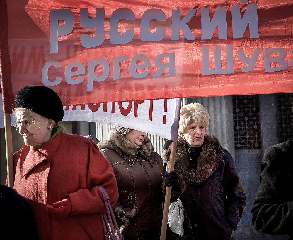 """Pro-Russian rally in front of Crimea Parliament . Up to 20 protesters ,mainly pensioners hold the banner with the  slogans : """"To the Russians of Crimea-Russian Power/Government"""" or """"Stop ethnic genocide of Russian Nation of Ukraine"""""""
