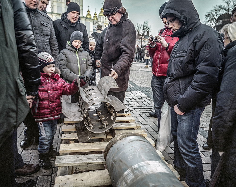Kiev,Ukraine, February 2015 Kiev residents watch armament ( allegedly Russian ) collected on the Front Line of Donbas war and displayed in Ukraine capitol center at the anniversary of Euro Maidan Revolution.