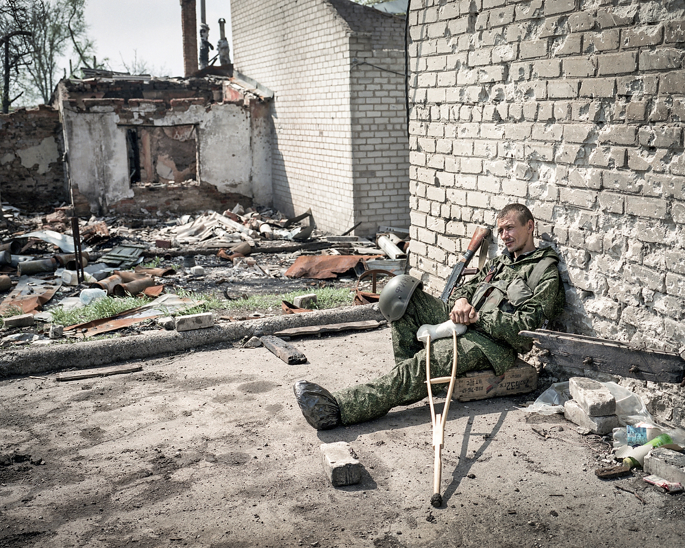 April 2015, Donetsk  Pro-Russian Rebel Sergey (nome de guerre Fixa) seats nearby Donetsk Airport. His Battalion  Somali along with two others took part in fights for the airport- which lasted for months and ended in Jan. 21 . 2015 with Ukrainian defeat.  Before the  war Sergey used to serve in National Guards of Ukraine  than he switched sides .  He was wounded in September 2014 during one of the attempts to storm the airport  by the rebels.