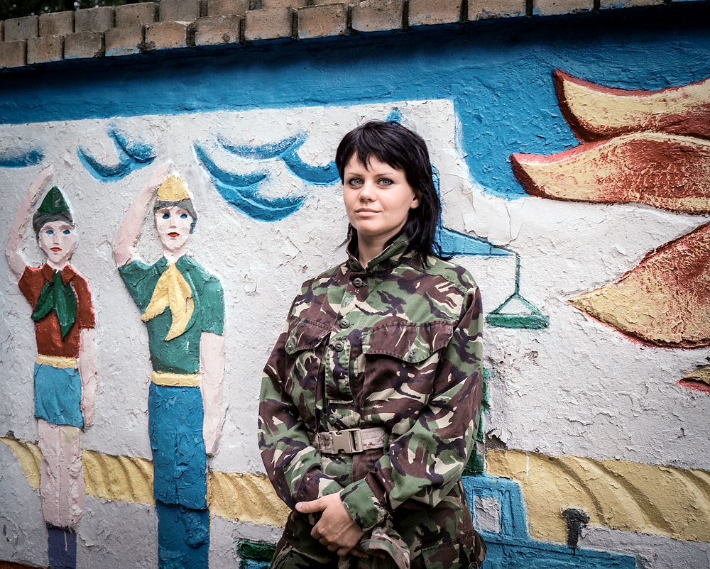 July  2014 , Dniepropetrovsk  , Ukraine  Masha  used to be a hairdresser in Luzhansk. She left her home town when the war started there  and joined Donbas Battalion in April  2014 to fight pro-Russian rebels (Luzhansk is one of the rebels strongholds)  . Eventually she left the army after Illovaysk battle, however she keeps her uniform and is ready to go back fight in necessary. In 2015 she was elected  as a member of City Council  of Vinnytsia , but  already doubts  she can make any substantial changes there.