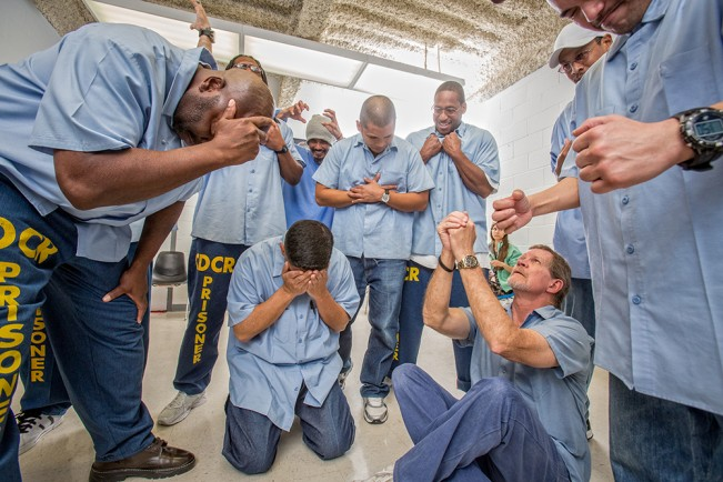 Students of Shakespearean theater warm up with an exercise, at Solano State Prison. 2015