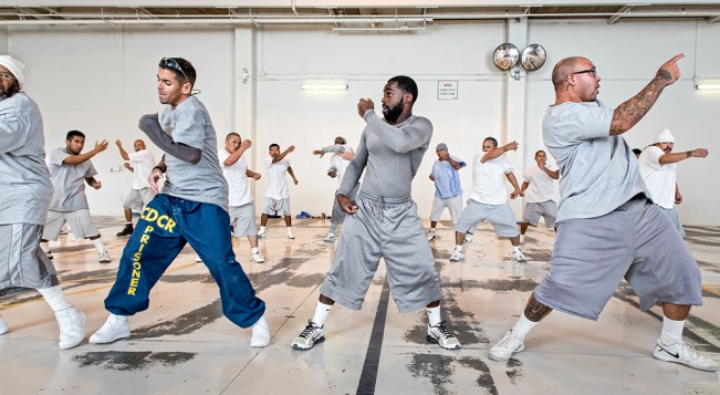 Students of hip-hop dance practice, in the gym at Ironwood State Prison. 2016