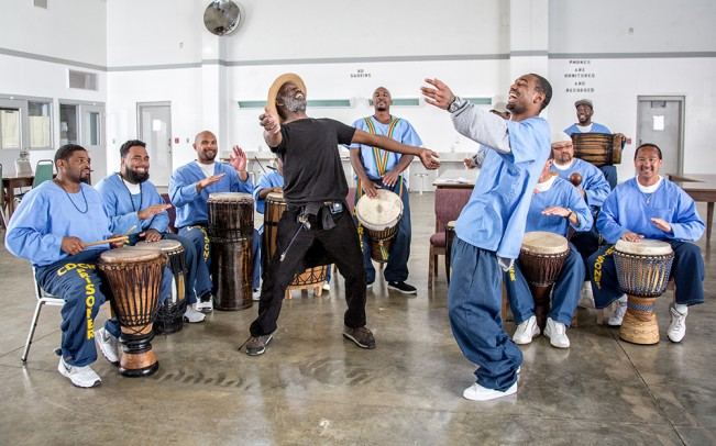 The instructor and a student dance during  drumming class, in a gym at Salinas Valley State Prison. 2015