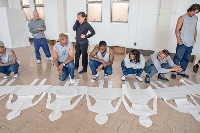 Movement + spoken word students and their instructor work on choreography, in the Protestant chapel at San Quentin State Prison. 2016