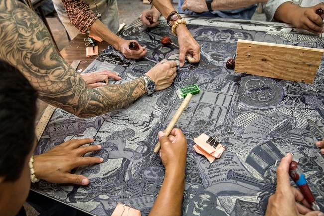 Carving a linoleum block for printing, in the art studio at San Quentin State Prison. 2008