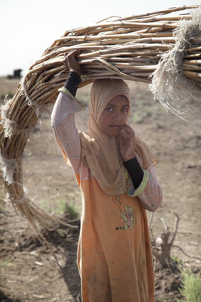 15.Marsh girl carrying reeeds