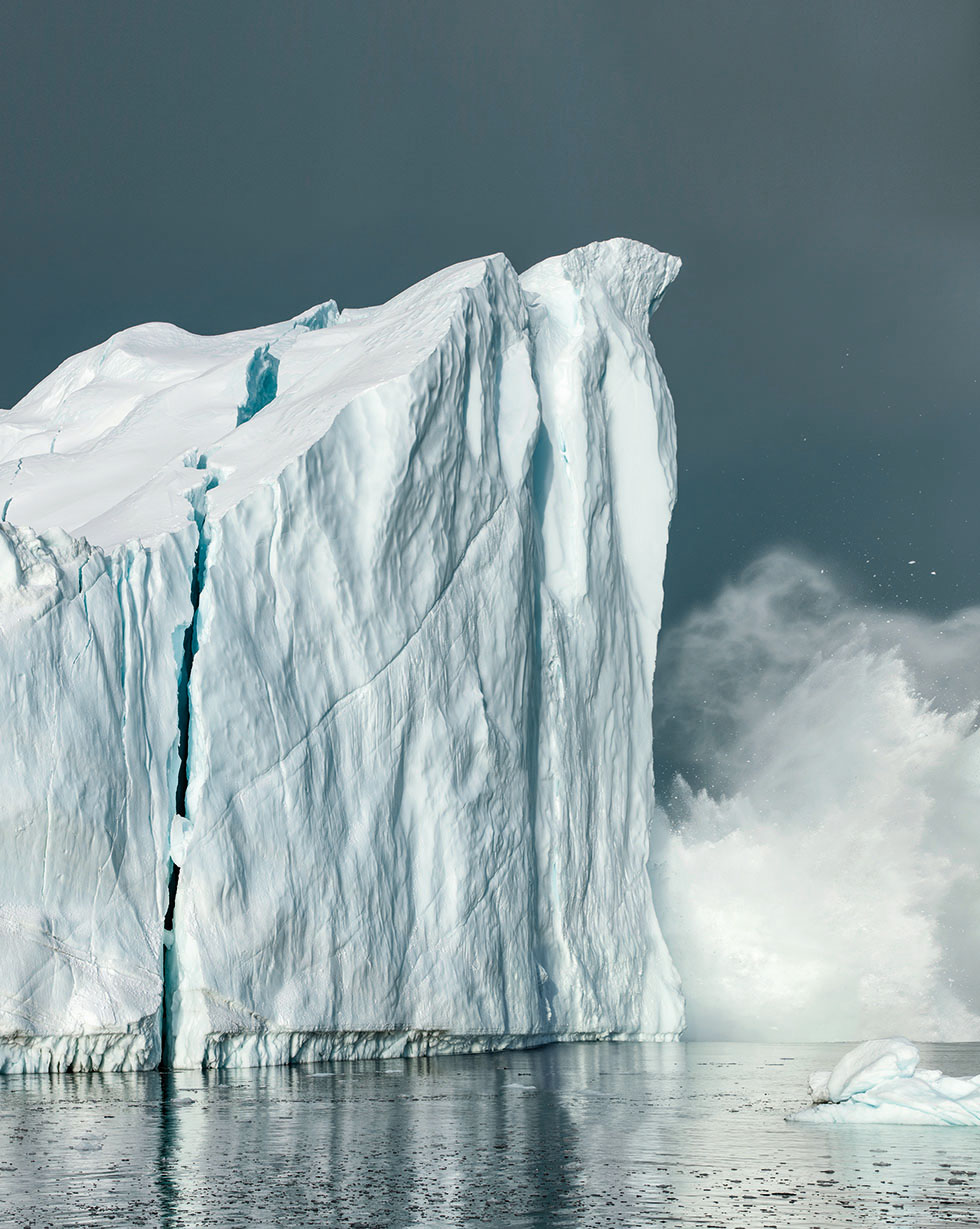 calving iceberg in the jacobshavn icefjord closed to ilulissat. size of the visible part of the glacier about 50 meter