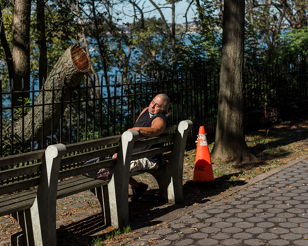 13_Far Apart by James Prochnik_Man Sunning on Bench by Chopped Tree_Y2A6319