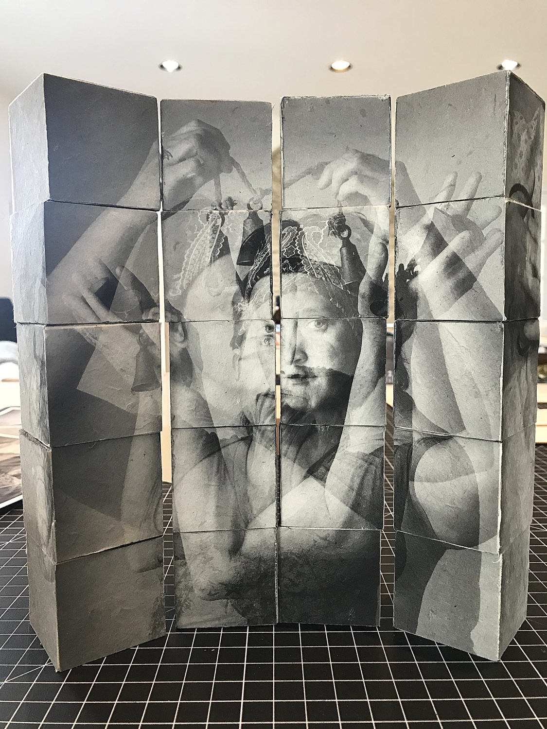 """Senses in Animate Project, 8""""x10' table top installation. Norwegian Pine with Photographic Images printed on Lohkta Paper, PVA, 6 sides of imagery each making a new puzzle image of a portrait from the series."""