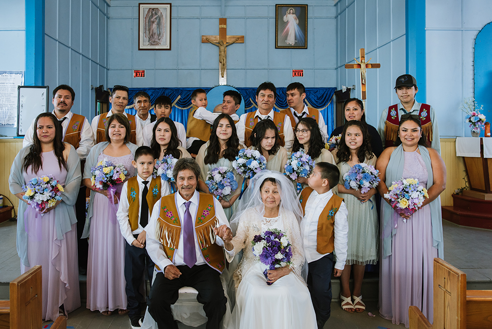 """After thirty-nine years as a couple, John Doctor, 65, and Pauline Zoe, 58, get married in St. Micheal's Catholic Church in the Tłı̨chǫ community of Behchokǫ̀. Doctor recently retired from the Rio Tinto owned Diavik Diamond Mine, one of three diamond mines operating in the Northwest Territories. """"We have a family but I figured it was time to make it official. I'm glad she said yes."""""""