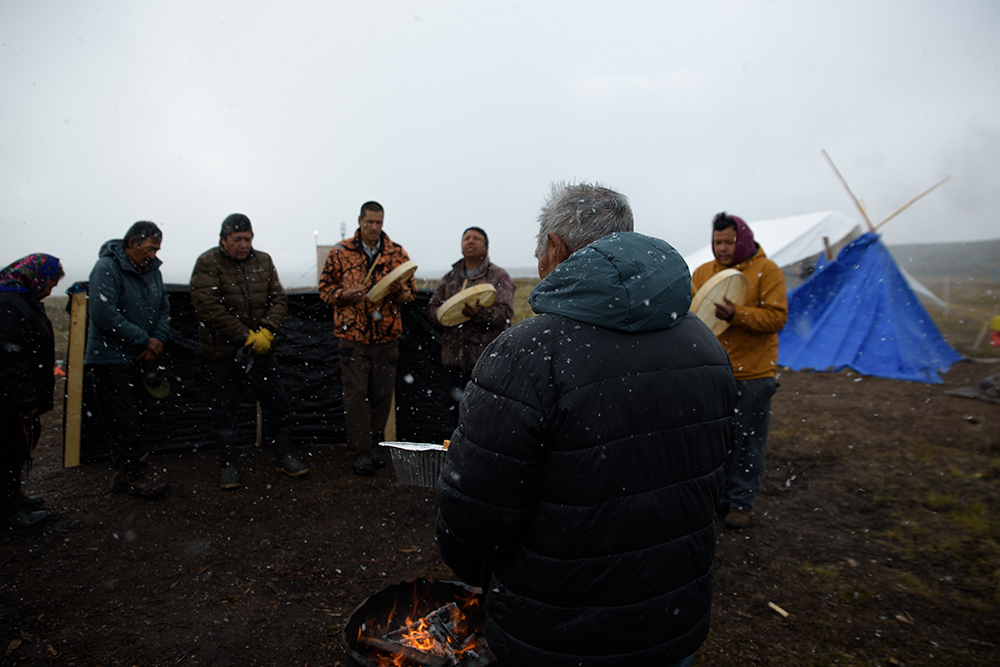 """Drummers pray and sing during a ceremony to """"feed the fire"""" at Kokètì (Contwoyto Lake), Northwest Territories - a way to ask the land for safety and protection."""