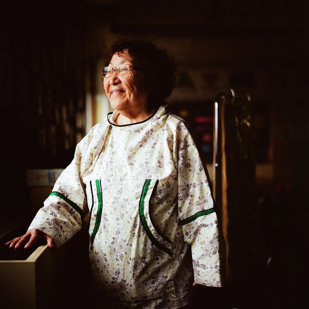 """""""My name is Ayaprun, one of 13 Yupíik names. My baptismal name is Ludwina, but then during high school, they started calling me Lottie, so I started being known as Lottie Jones, originally from Scammon Bay, Alaska. Iím one of nine sisters and a brother, which includes two adopted brothers and an adopted sister, so 13 in the family. I was the first to graduate from high school, then the first to graduate from collegeóin fact, in the whole village. I went to college on campus at UAF, got my degree in 1972, and I have been teaching here ever since. From 1972-90 it was kindergarten English. From 1992-95 I taught YSLóthatís Yupíik as a second language. [My mother's] biggest peeve was ìI need to get a translator to talk to my own grandchildren, my great grandchildren.î She didnít like that. Thinking about that made me want to work harder to change that. It seems like the bigger our school becomes, the harder we must work to make the Yupíik language really productive. When we were in the small building, kids didnít hear any English because we were in a closed environment. Now we need to really work on having them speak more Yupíik. Listen to what those kids are speaking out there in the hallóEnglish. I dream in Yupíik. You can be a real Yupíik even if you donít speak your language, because what if the opportunity to speak it wasnít there? But yet you live your subsistence lifestyleóthatís Yupíik. But to make that element whole, you need the language, the lifestyle, and the culture. Never think you are not Yupíik because you canít speak the language. You might think Iím a fluent speaker, but when I was with my mother, I was always asking, 'What does that mean?'"""".--Ludwina Jones, Yupíik Language Immersion Teacher at the Ayaprun Elitnaurvik School in Bethel, Alaska. The mission of the school ìis to help strengthen Yup'ik language and culture, to promote understanding of cultural differences, to enhance one's own"""